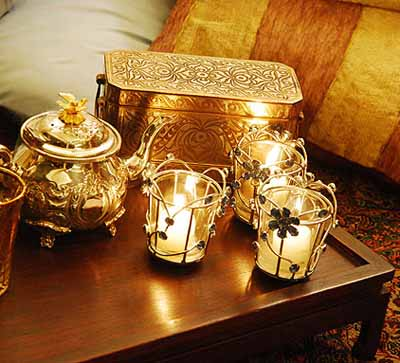 tea lights and golden tea pot for arabic theme party table decorating