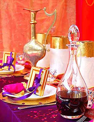 arabic drinks and party table decorations in bright pirple golden and pink colors & Arabian Nights Themed Party Table Decorating Ideas