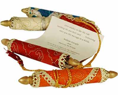 colorful red and orange invitations for arabian nights themed party rolled in persian carpet style