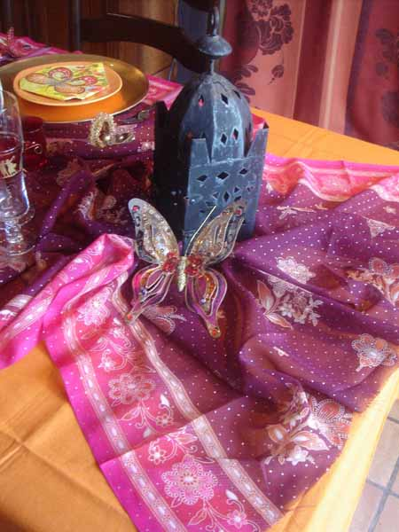 moroccan lanterns and decorative fabrics in pink and purple colors