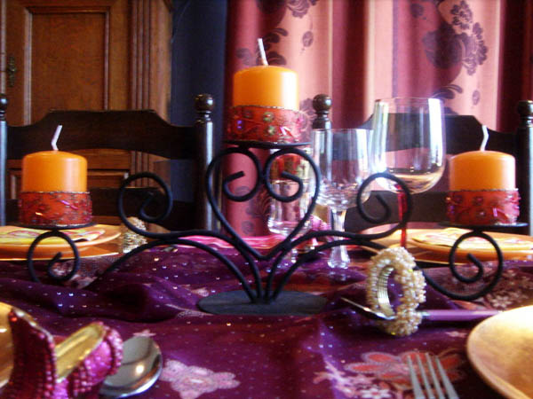 table centerpieces with candles in wrought iron candle holders are exotic arabian nights themed party decorations