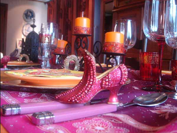 pink shoe decorated with glass beads table centerpiece idea