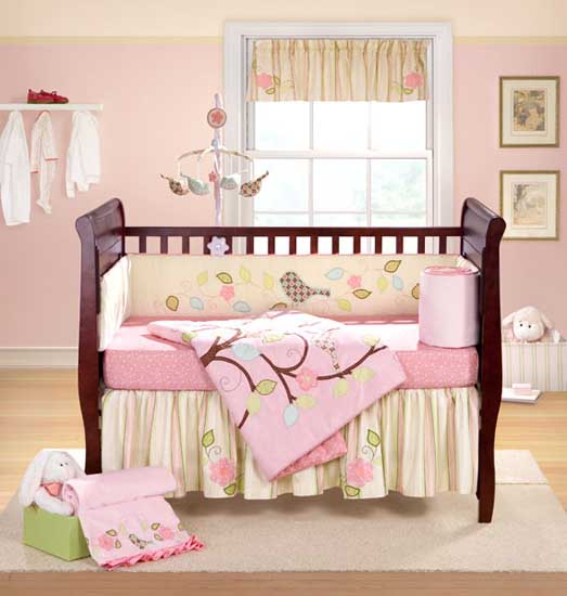 baby room decorating with crafts and bird decorations in pink color