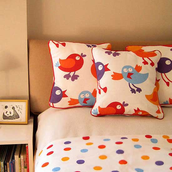 red and blue kids bedding with birds images on pillows