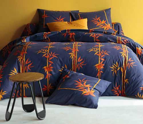 floral bedding in blue and orange color introduces modern bedroom color trends