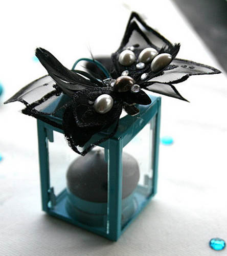 glass candle holder and table centerpiece ideas in black and turquoise colors