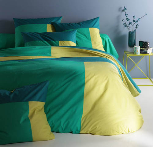green turquoise and yellow bedding sets create modern bedroom decor