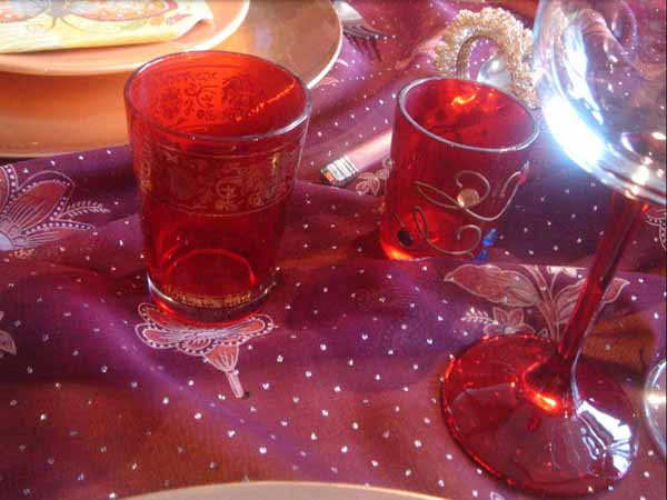 colorful glasses with tea light candles for table decorating