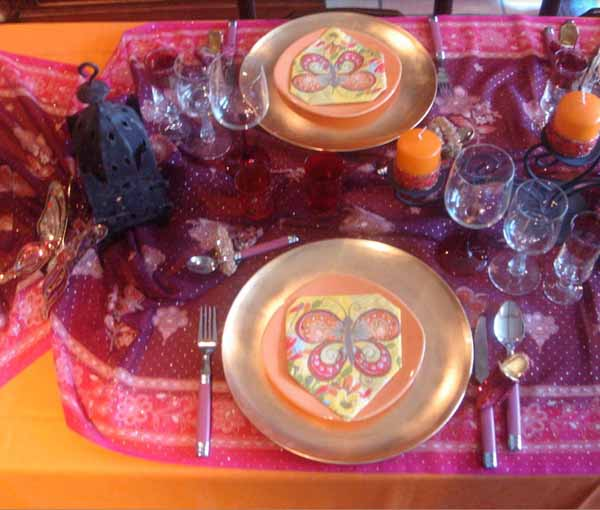 morrocan style party table setting with golden plates