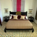 arabic bedroom decor with white and pink flowera and floor tyles in a traditional Moroccan style