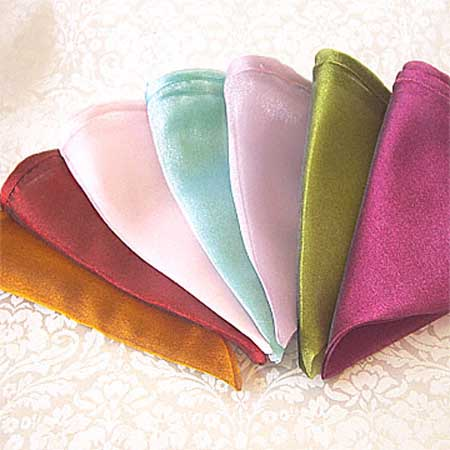 colorful napkins for table decoration in light blue olive green pink lilac and golden colors