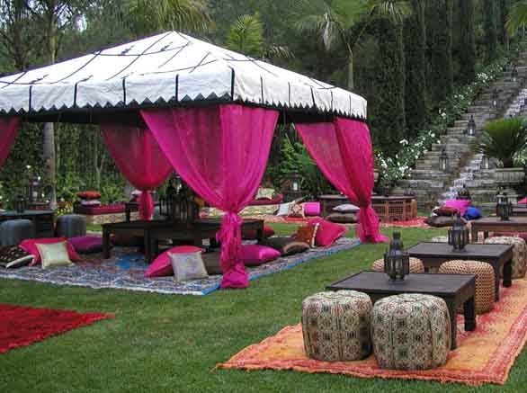 pink tent and floor cushions for morrocan style party decorating