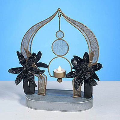 palm trees candle holder and table centerpiece idea for arabian nights party theme