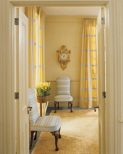 light yellow paint and curtains with gray stripes are light fall decorating ideas