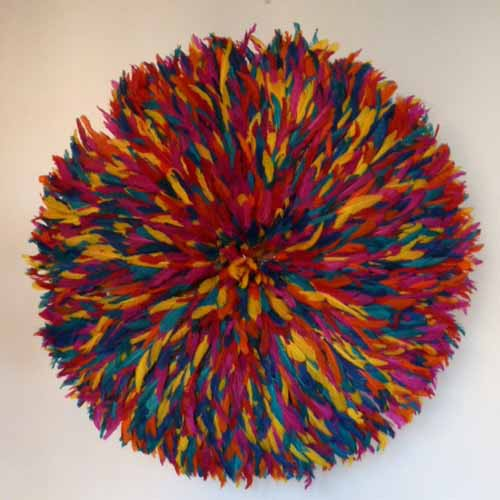 juju hat made of colorful bird feathers are modern wall decor ideas
