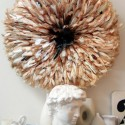 juju hat made of brown and white bird feathers used for modern wall decor