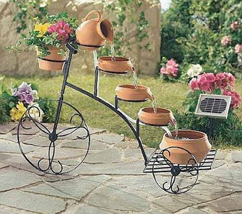 antique bicycle used for making a water fountain and garden decorations