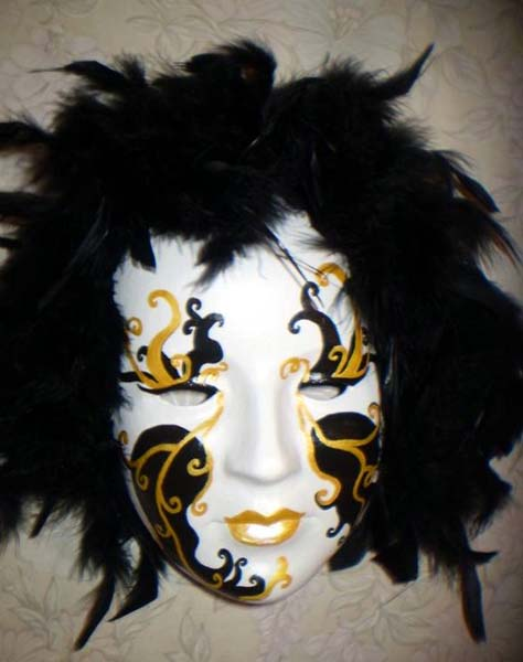 black masquerade masks with feathers decorations are creative craft ideas