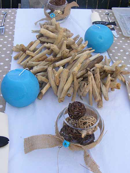 driftwood craft ideas with candles and wood sticks for table decoration