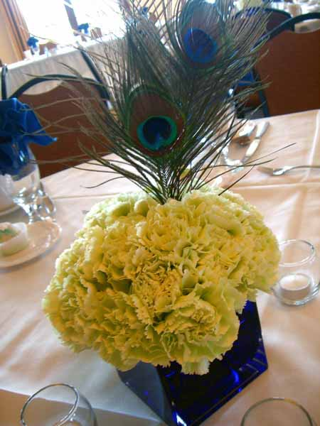 peacook feather decorations and yellow flowers centepiece ideas