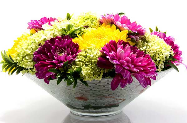yellow and purple flowers for making simple centerpieces for table decoration