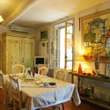 french country furniture, wooden dining table with chairs and bright wall decoration