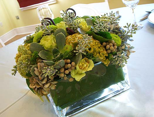 green leaves and yellow flowers are beautiful centerpiece ideas for eco homes