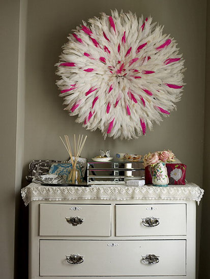 juju hats made of white and pink bird feathers are modern wall decorations