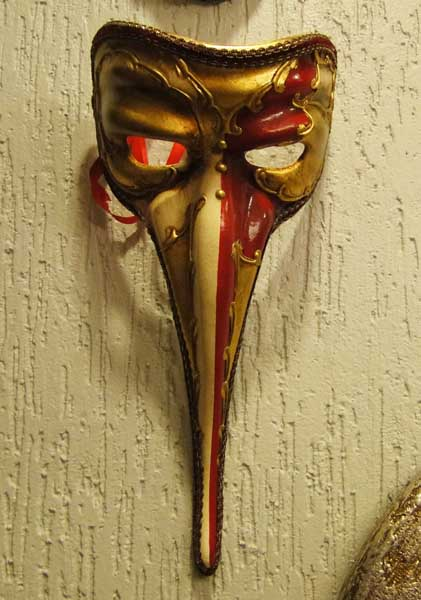 masquerade mask in golden and red colors for creating unique wall decor ideas with venetian masks