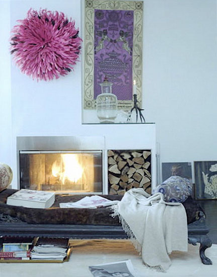 pink juju hat over fireplace is modern wall decor idea
