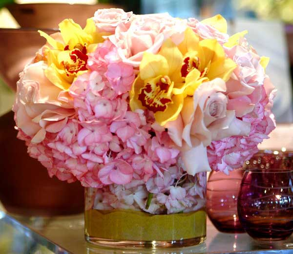 pink and yellow flowers in floral arrangements offer charming centerpiece ideas