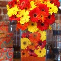 red and yellow flowers create festive table decoration ideas