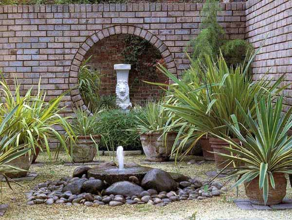 simple backyard landscaping ideas that inslude diy water fountain design