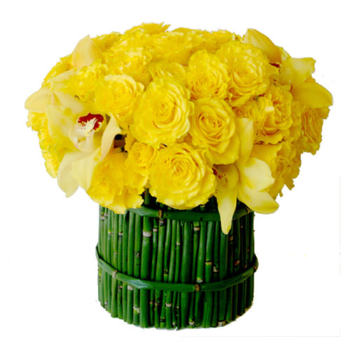 short green bamboo sticks and yellow roses are eco friendly table centerpiece ideas
