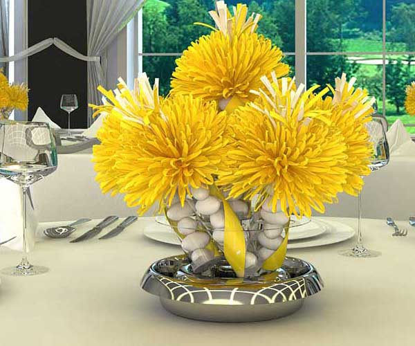 beach pebbles or small rocks with yellow flowers offer creative eco friendly centerpiece ideas