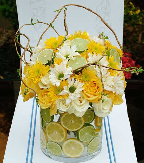 white and yellow flowers and fruits for table centepiece ideas