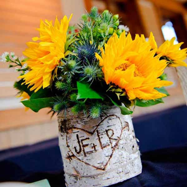 sunflowers and green leaves are beautiful floral centerpiece ideas fr table decoration