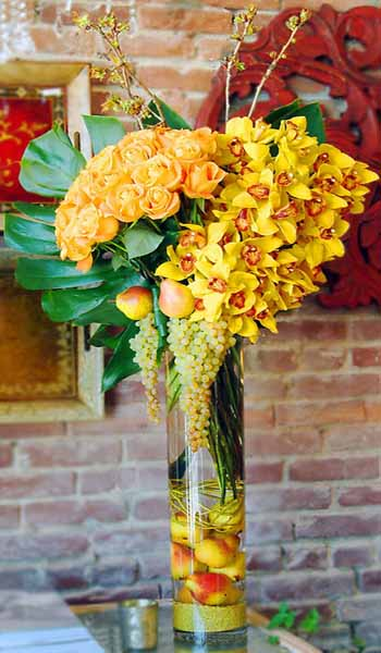 yellow roses, narcissus, orchids and fruits offer unique centerpiece ideas