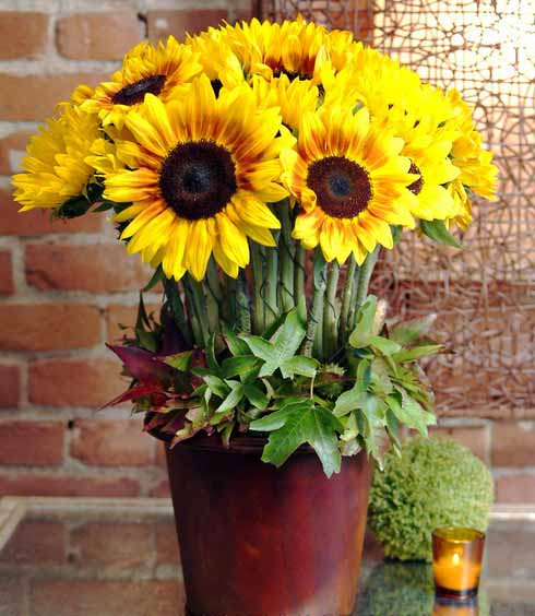 tea candles sunflowers and green leaves centerpiece ideas