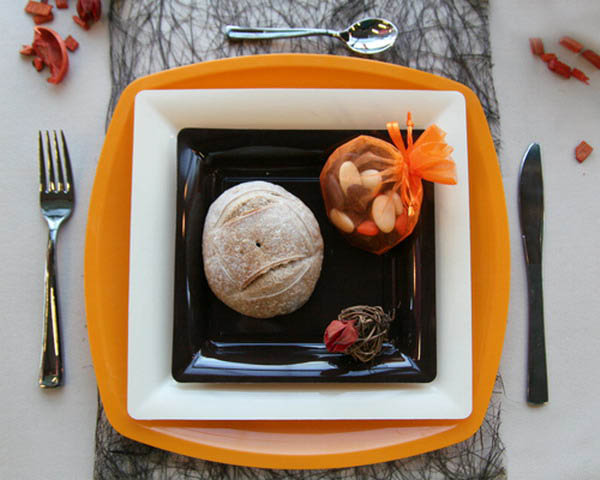 black and white with orange plates are halloween decoration ideas