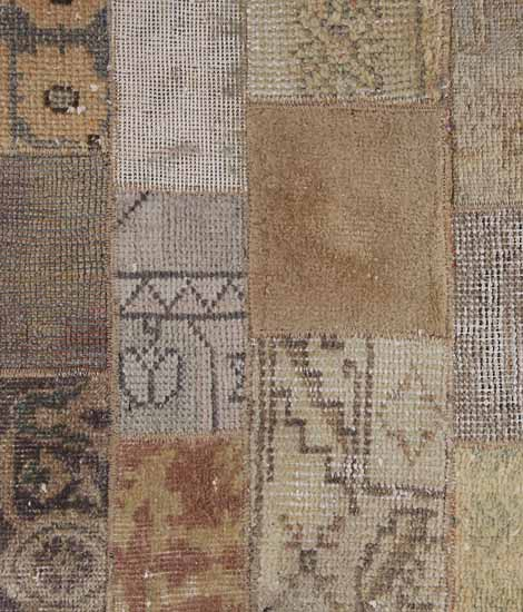 broqn and gray oriental rug made in patchwork fabric pattern