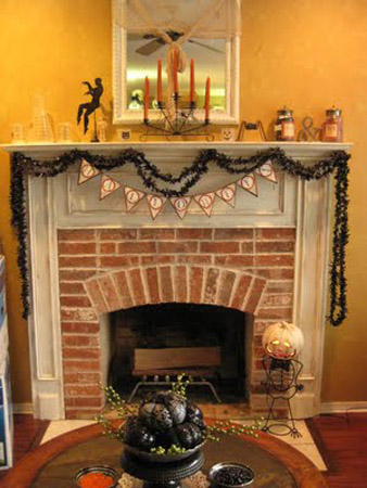 fireplace decoration with pumpkins and black garland