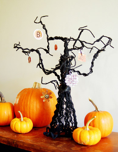 creative fall crafts, halloween decorations and ideas with black mini tree and orange pumpkins