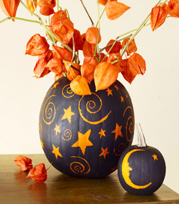 black and orange color combination for pumpkin and flower centerpiece ideas with carved stars