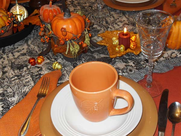 orange dinnerware mugs with leaf pattern for thanksgiving table decoration