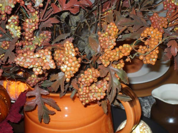 tree branches with berries for thanksgiving table decoration