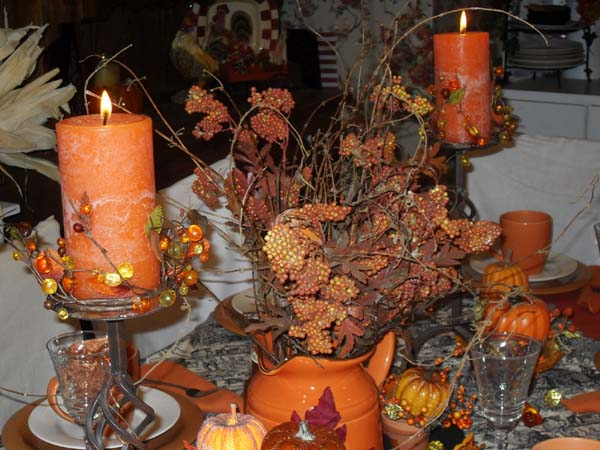 orange cendles centerpieces and btanches for thanksgiving decorating