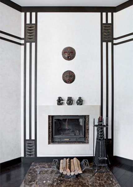 fireplace and wall decoration with indonesian art and handicrafts