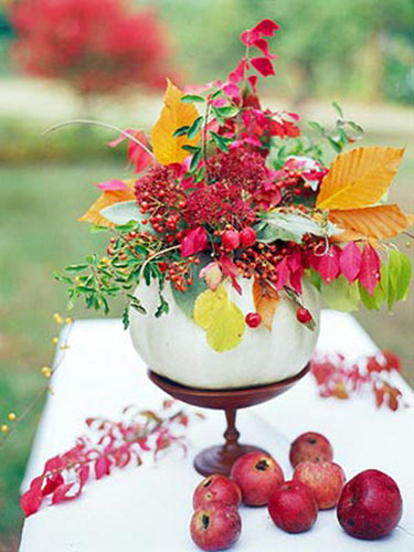 white pumpkin vase with fall leaves and apples