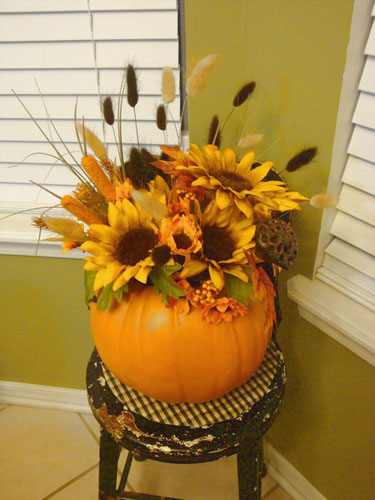 sunflowers in pumpkin vase